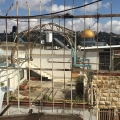 What is the story behind the house adjacent to Al-Aqsa?